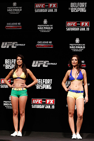 SAO PAULO, BRAZIL - JANUARY 18:  (L-R) UFC Octagon Girls Camila Rodrigues de Oliveira and Aline Caroline Franzoi stand on stage during the UFC on FX official weigh-in event on January 18, 2013 at Ibirapuera Gymnasium in Sao Paulo, Brazil. (Photo by Josh Hedges/Zuffa LLC/Zuffa LLC via Getty Images)