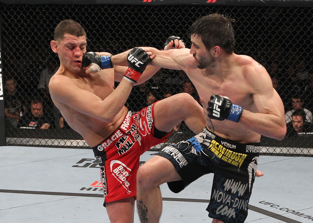 LAS VEGAS - FEBRUARY 04:  (R-L) Carlos Condit punches Nick Diaz during the UFC 143 event at Mandalay Bay Events Center on February 4, 2012 in Las Vegas, Nevada.  (Photo by Nick Laham/Zuffa LLC/Zuffa LLC via Getty Images) *** Local Caption *** Carlos Condit; Nick Diaz