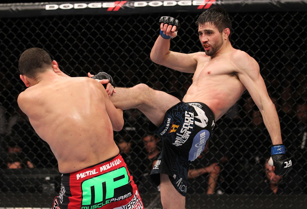 LAS VEGAS - FEBRUARY 04:  (R-L) Carlos Condit kicks Nick Diaz during the UFC 143 event at Mandalay Bay Events Center on February 4, 2012 in Las Vegas, Nevada.  (Photo by Nick Laham/Zuffa LLC/Zuffa LLC via Getty Images) *** Local Caption *** Carlos Condit; Nick Diaz