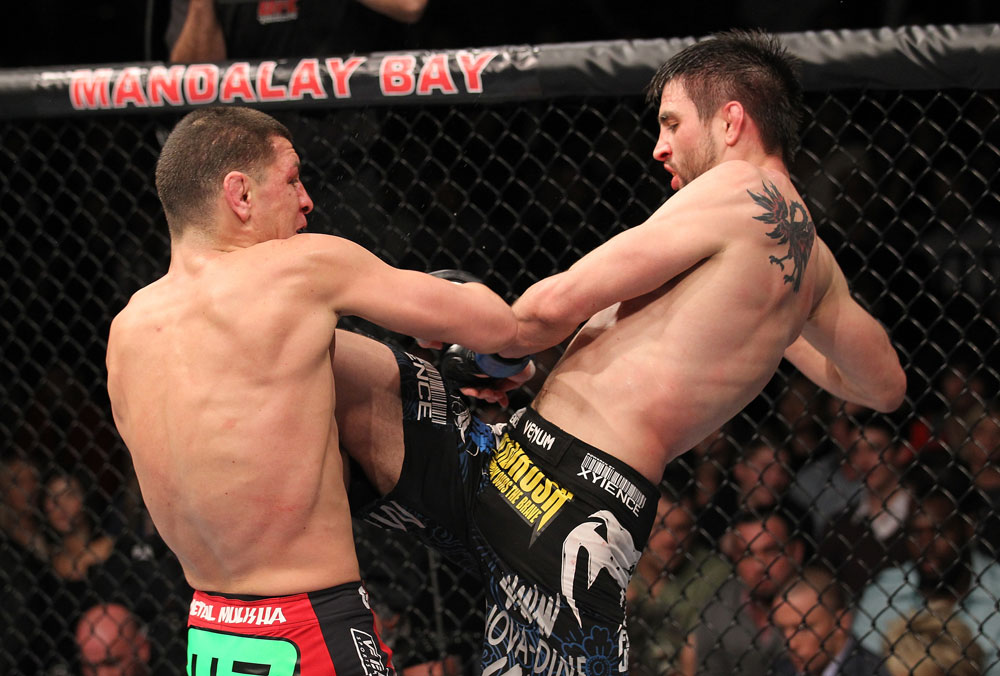 LAS VEGAS - FEBRUARY 04:  Carlos Condit (right) hits Nick Diaz with a knee during the UFC 143 event at Mandalay Bay Events Center on February 4, 2012 in Las Vegas, Nevada.  (Photo by Nick Laham/Zuffa LLC/Zuffa LLC via Getty Images) *** Local Caption *** Nick Diaz; Carlos Condit