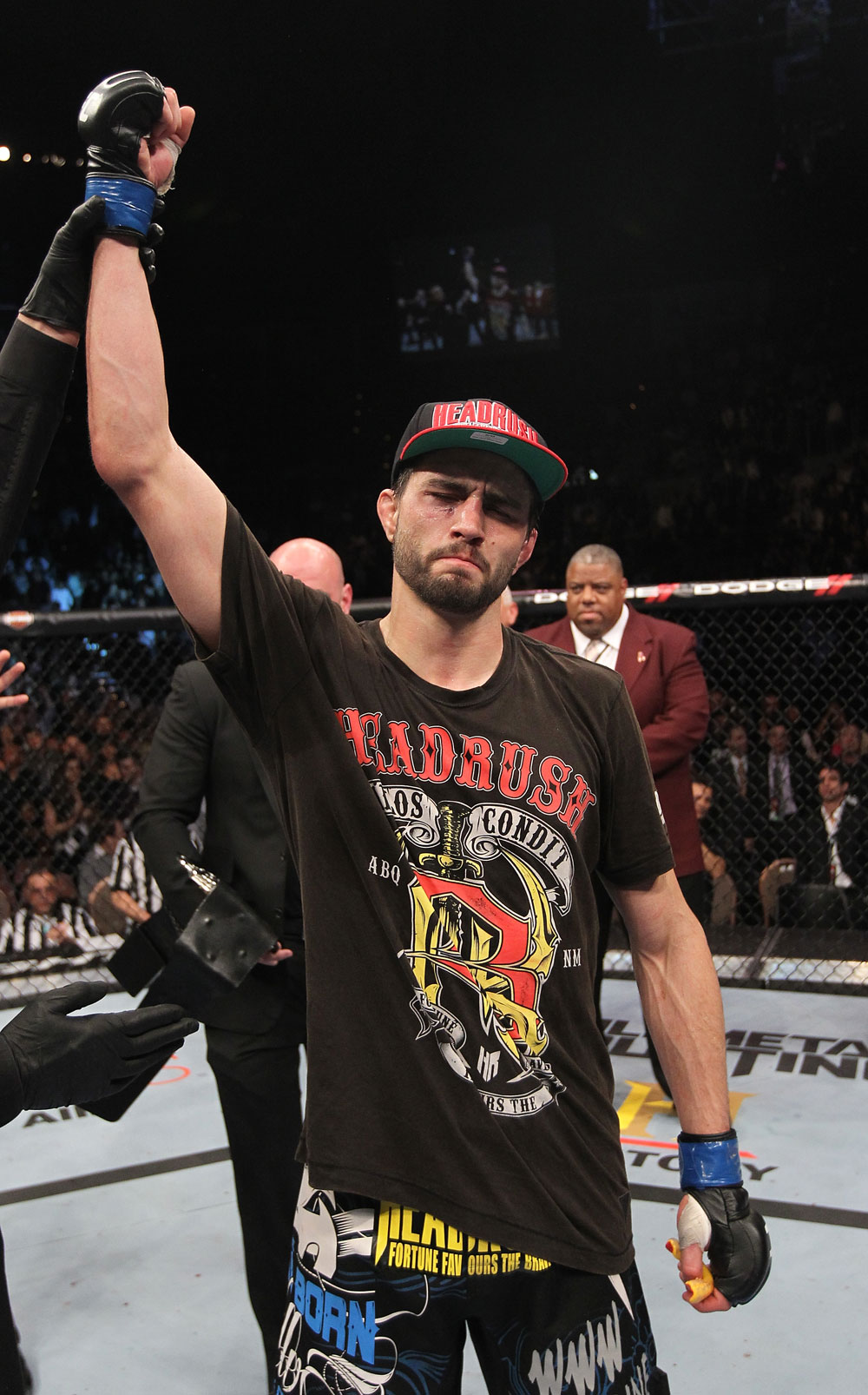 LAS VEGAS - FEBRUARY 04:  Carlos Condit is declared the winner in his fight with Nick Diaz during the UFC 143 event at Mandalay Bay Events Center on February 4, 2012 in Las Vegas, Nevada.  (Photo by Nick Laham/Zuffa LLC/Zuffa LLC via Getty Images) *** Local Caption *** Carlos Condit