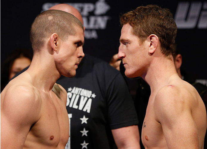 SACRAMENTO, CA - DECEMBER 13:  (L-R) Opponents Joe Lauzon and Mac Danzig weighs in during the UFC on FOX weigh-in at Sleep Train Arena on December 13, 2013 in Sacramento, California. (Photo by Josh Hedges/Zuffa LLC/Zuffa LLC via Getty Images)