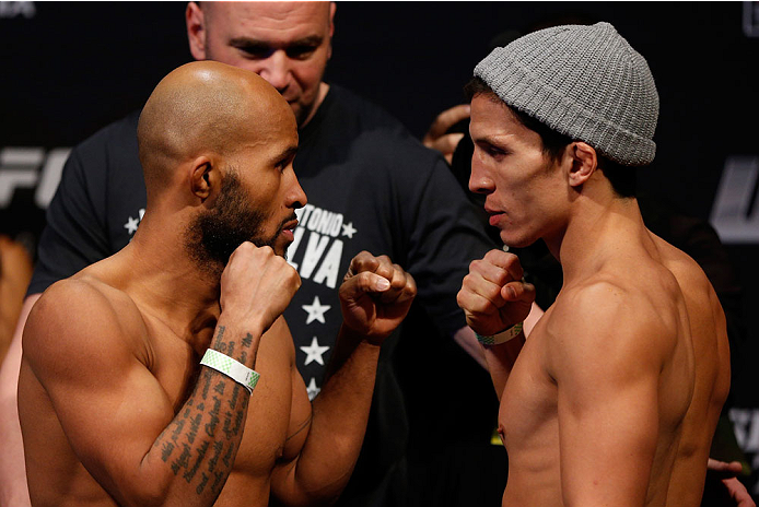 SACRAMENTO, CA - DECEMBER 13:  (L-R) Opponents Demetrious Johnson and Joseph Benavidez face off during the UFC on FOX weigh-in at Sleep Train Arena on December 13, 2013 in Sacramento, California. (Photo by Josh Hedges/Zuffa LLC/Zuffa LLC via Getty Images)