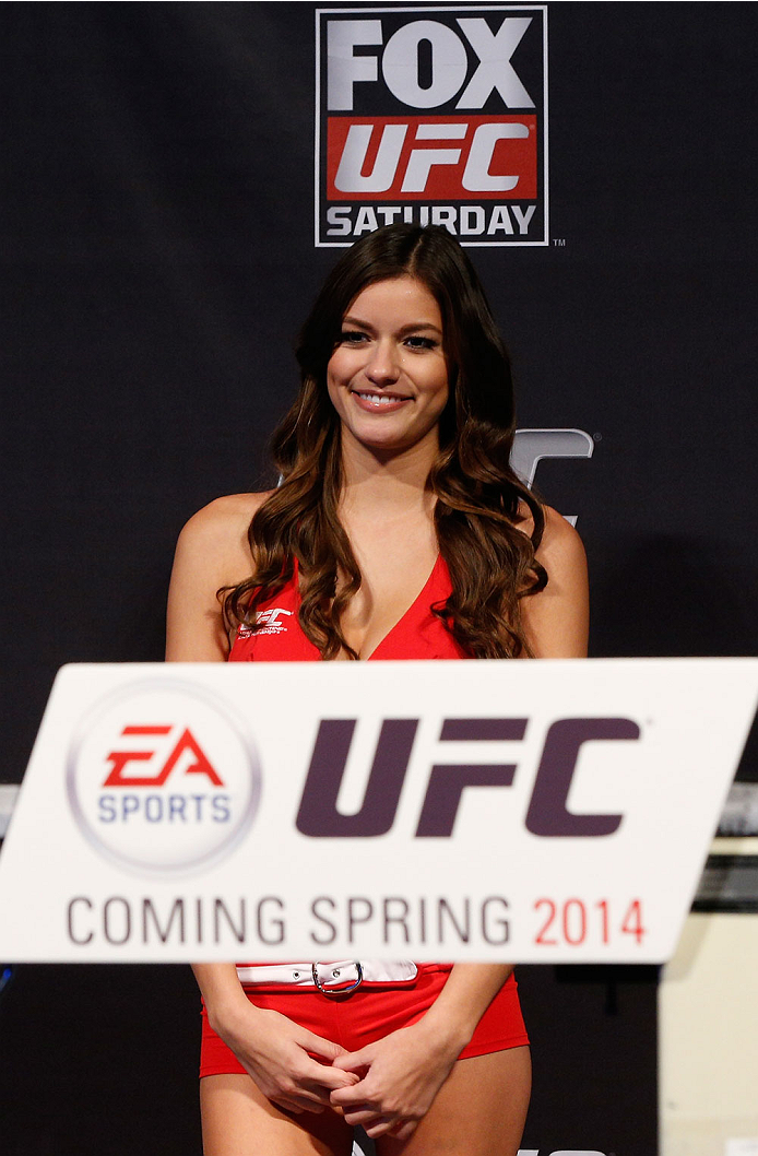 SACRAMENTO, CA - DECEMBER 13:  UFC Octagon Girl Vanessa Hanson stands on stage during the announcement of the EA Sports UFC videogame cover vote before the UFC on FOX weigh-in at Sleep Train Arena on December 13, 2013 in Sacramento, California. (Photo by Josh Hedges/Zuffa LLC/Zuffa LLC via Getty Images)
