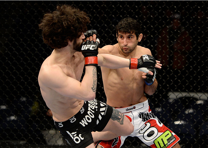 DULUTH, GA - JANUARY 15:  (R-L) Beneil Dariush lands a punch to Charlie Brenneman in their welterweight fight during the UFC Fight Night event inside The Arena at Gwinnett Center on January 15, 2014 in Duluth, Georgia. (Photo by Jeff Bottari/Zuffa LLC/Zuffa LLC via Getty Images)