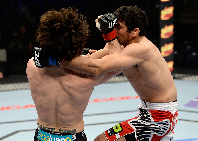 DULUTH, GA - JANUARY 15: (L-R) Charlie Brenneman lands a punch to Beneil Dariush in their welterweight fight during the UFC Fight Night event inside The Arena at Gwinnett Center on January 15, 2014 in Duluth, Georgia. (Photo by Jeff Bottari/Zuffa LLC/Zuffa LLC via Getty Images)