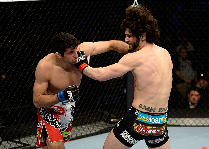 DULUTH, GA - JANUARY 15:  (L-R) Beneil Dariush fights Charlie Brenneman in their welterweight fight during the UFC Fight Night event inside The Arena at Gwinnett Center on January 15, 2014 in Duluth, Georgia. (Photo by Jeff Bottari/Zuffa LLC/Zuffa LLC via Getty Images)