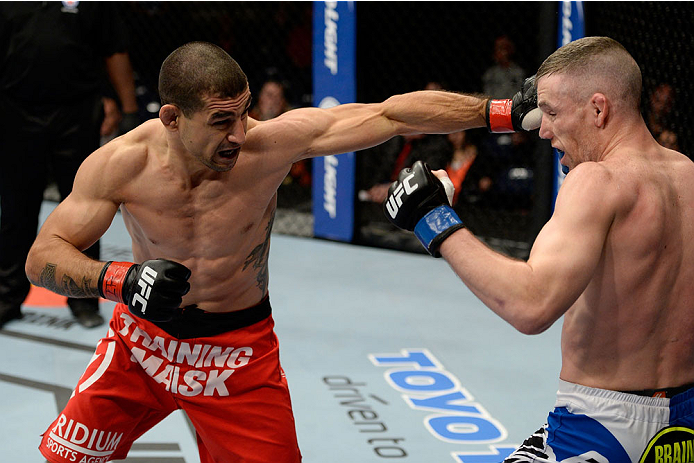 DULUTH, GA - JANUARY 15: (L-R) Vinc Pichel lands a punch to Garett Whiteley in their lightweight fight during the UFC Fight Night event inside The Arena at Gwinnett Center on January 15, 2014 in Duluth, Georgia. (Photo by Jeff Bottari/Zuffa LLC/Zuffa LLC via Getty Images)