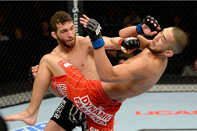 DULUTH, GA - JANUARY 15: (L-R) Alpetkin Ozkilic punches Louis Smolka in their featherweight fight during the UFC Fight Night event inside The Arena at Gwinnett Center on January 15, 2014 in Duluth, Georgia.  (Photo by Jeff Bottari/Zuffa LLC/Zuffa LLC via Getty Images)