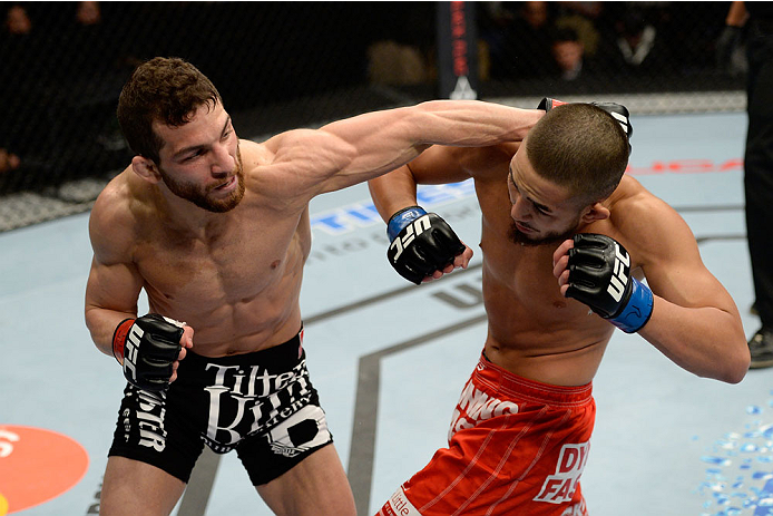 DULUTH, GA - JANUARY 15:  (L-R) Alpetkin Ozkilic lands a punch to Louis Smolka in their featherweight fight during the UFC Fight Night event inside The Arena at Gwinnett Center on January 15, 2014 in Duluth, Georgia. (Photo by Jeff Bottari/Zuffa LLC/Zuffa LLC via Getty Images)