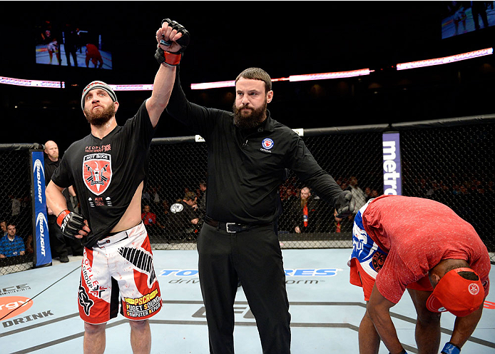 DULUTH, GA - JANUARY 15: (L-R) Trevor Smith reacts after winning a split decision with Brian Houston in their middleweight fight during the UFC Fight Night event inside The Arena at Gwinnett Center on January 15, 2014 in Duluth, Georgia. (Photo by Jeff Bottari/Zuffa LLC/Zuffa LLC via Getty Images)