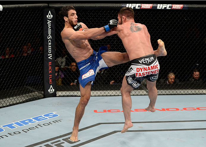 DULUTH, GA - JANUARY 15:  (L-R) Elias Silverio kicks Isaac Vallie-Flagg in their lightweight fight during the UFC Fight Night event inside The Arena at Gwinnett Center on January 15, 2014 in Duluth, Georgia. (Photo by Jeff Bottari/Zuffa LLC/Zuffa LLC via Getty Images)