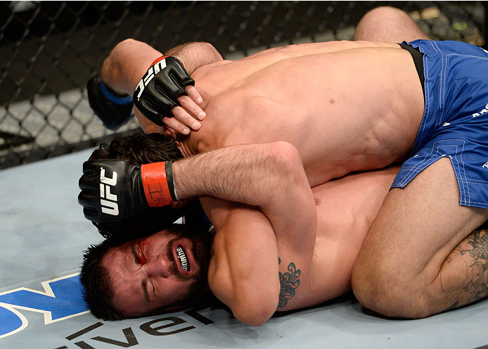 DULUTH, GA - JANUARY 15:  Elias Silverio (Top) battles Isaac Vallie-Flagg on the mat in their lightweight fight during the UFC Fight Night event inside The Arena at Gwinnett Center on January 15, 2014 in Duluth, Georgia. (Photo by Jeff Bottari/Zuffa LLC/Zuffa LLC via Getty Images)