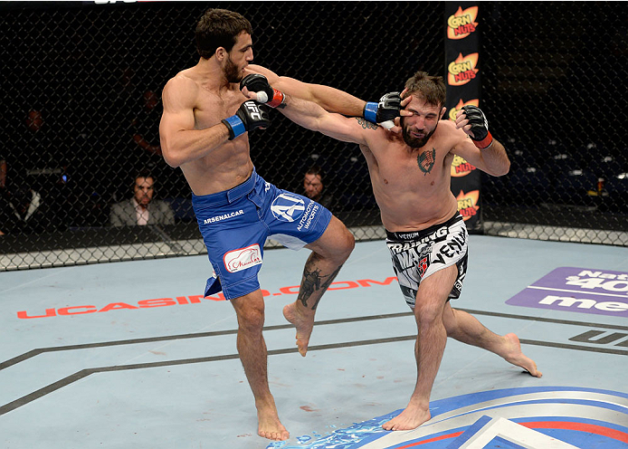 DULUTH, GA - JANUARY 15: (L-R) Elias Silverio battles Isaac Vallie-Flagg in their lightweight fight during the UFC Fight Night event inside The Arena at Gwinnett Center on January 15, 2014 in Duluth, Georgia. (Photo by Jeff Bottari/Zuffa LLC/Zuffa LLC via Getty Images)