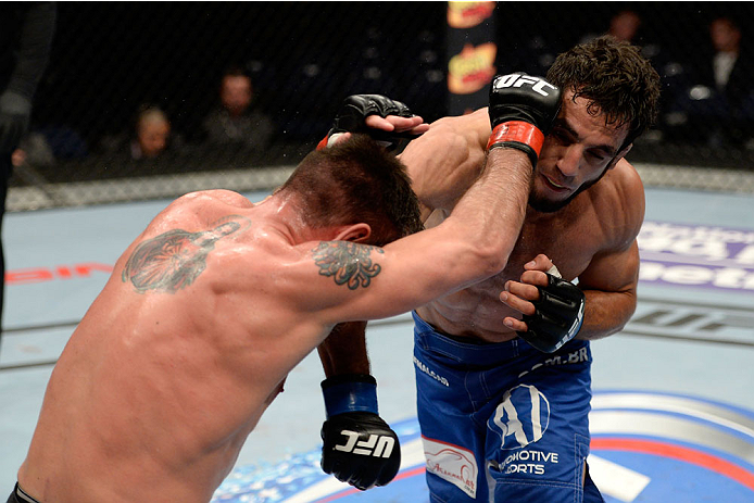 DULUTH, GA - JANUARY 15: (R-L) Elias Silverio lands a punch to Isaac Vallie-Flagg in their lightweight fight during the UFC Fight Night event inside The Arena at Gwinnett Center on January 15, 2014 in Duluth, Georgia. (Photo by Jeff Bottari/Zuffa LLC/Zuffa LLC via Getty Images)