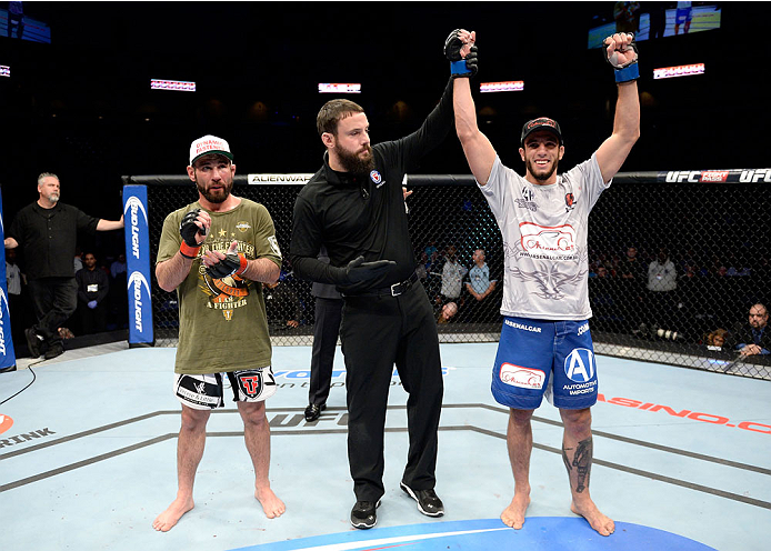 DULUTH, GA - JANUARY 15: (R-L) Elias Silverio reacts after winning by decision over Isaac Vallie-Flagg in their lightweight fight during the UFC Fight Night event inside The Arena at Gwinnett Center on January 15, 2014 in Duluth, Georgia. (Photo by Jeff Bottari/Zuffa LLC/Zuffa LLC via Getty Images)