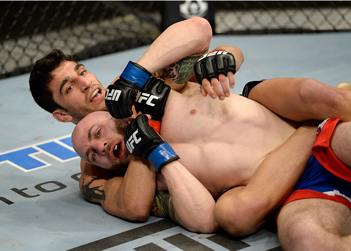DULUTH, GA - JANUARY 15: Ramsey Nijem (Top) battles Justin Edwards in their lightweight fight during the UFC Fight Night event inside The Arena at Gwinnett Center on January 15, 2014 in Duluth, Georgia. (Photo by Jeff Bottari/Zuffa LLC/Zuffa LLC via Getty Images)
