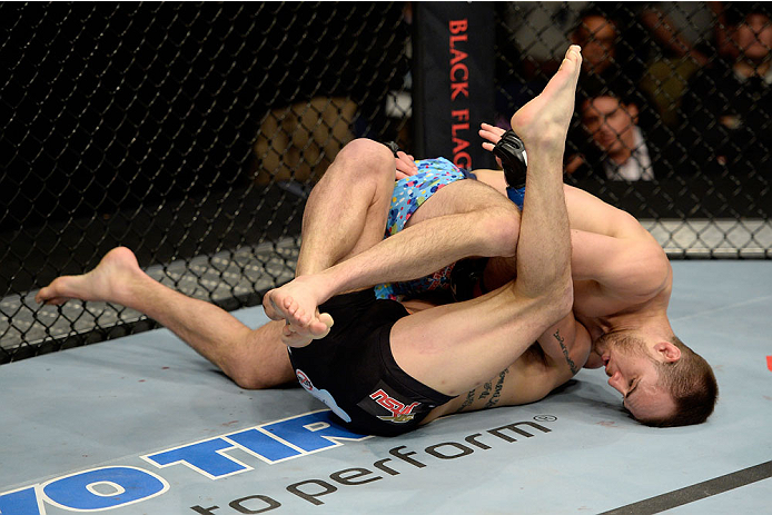 DULUTH, GA - JANUARY 15:  Cole Miller (Top) takes Sam Sicilia to the mat in their featherweight fight during the UFC Fight Night event inside The Arena at Gwinnett Center on January 15, 2014 in Duluth, Georgia. (Photo by Jeff Bottari/Zuffa LLC/Zuffa LLC via Getty Images)