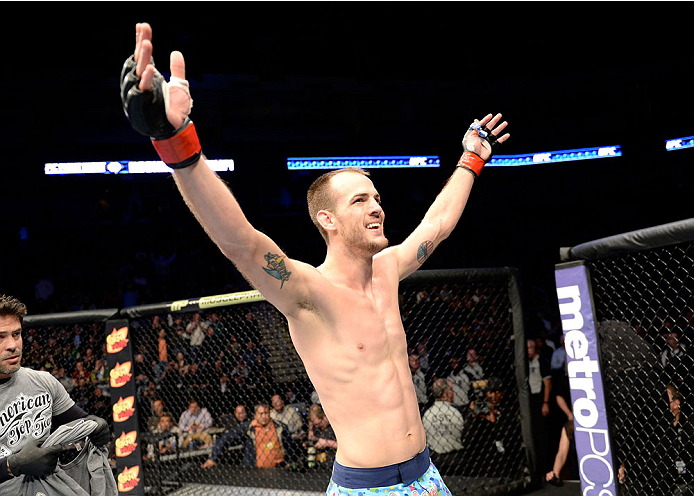 DULUTH, GA - JANUARY 15:  Cole Miller reacts after the win against Sam Sicilia in their featherweight fight during the UFC Fight Night event inside The Arena at Gwinnett Center on January 15, 2014 in Duluth, Georgia. (Photo by Jeff Bottari/Zuffa LLC/Zuffa LLC via Getty Images)