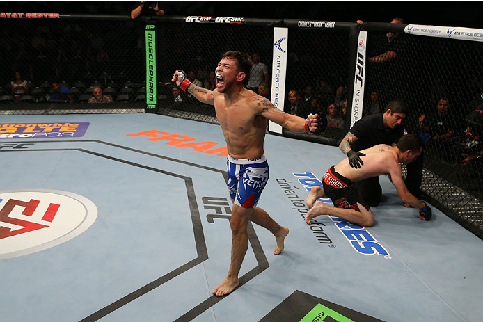 SAN ANTONIO, TX - JUNE 28:  Ray Borg (blue shorts) reacts to his victory over Shane Howell in their flyweight bout at the AT&T Center on June 28, 2014 in San Antonio, Texas. (Photo by Ed Mulholland/Zuffa LLC/Zuffa LLC via Getty Images)