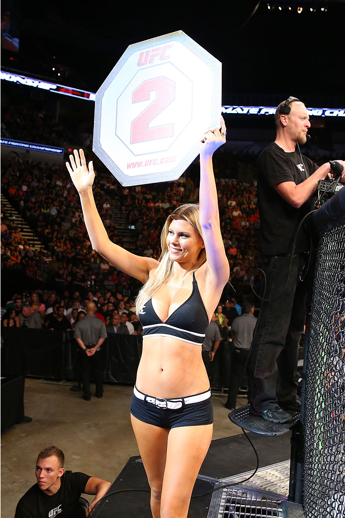 SAN ANTONIO, TX - JUNE 28:  UFC Octagon Girl Chrissy Blair introduces round two of Hester vs Neto during their middleweight bout at the AT&T Center on June 28, 2014 in San Antonio, Texas. (Photo by Ed Mulholland/Zuffa LLC/Zuffa LLC via Getty Images)
