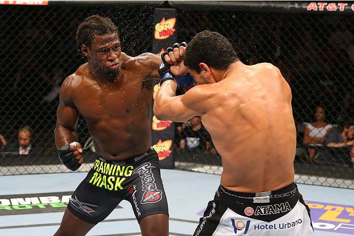 SAN ANTONIO, TX - JUNE 28:  (L-R) Clint Hester punches Antonio Braga Neto in their middleweight bout at the AT&T Center on June 28, 2014 in San Antonio, Texas. (Photo by Ed Mulholland/Zuffa LLC/Zuffa LLC via Getty Images)