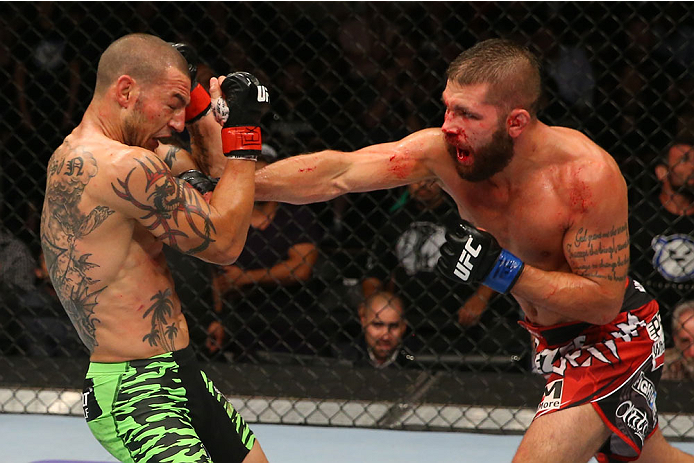 SAN ANTONIO, TX - JUNE 28:  (R-L) Jeremy Stephens punches Cub Swanson in their featherweight bout at the AT&T Center on June 28, 2014 in San Antonio, Texas. (Photo by Ed Mulholland/Zuffa LLC/Zuffa LLC via Getty Images)