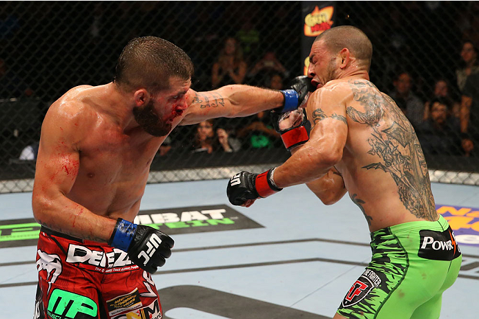 SAN ANTONIO, TX - JUNE 28:  (L-R) Jeremy Stephens punches Cub Swanson in their featherweight bout at the AT&T Center on June 28, 2014 in San Antonio, Texas. (Photo by Ed Mulholland/Zuffa LLC/Zuffa LLC via Getty Images)
