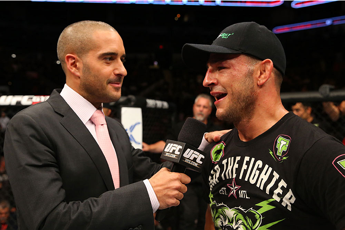 SAN ANTONIO, TX - JUNE 28:  Cub Swanson (right) speaks with Jon Anik after his featherweight bout at the AT&T Center on June 28, 2014 in San Antonio, Texas. (Photo by Ed Mulholland/Zuffa LLC/Zuffa LLC via Getty Images)