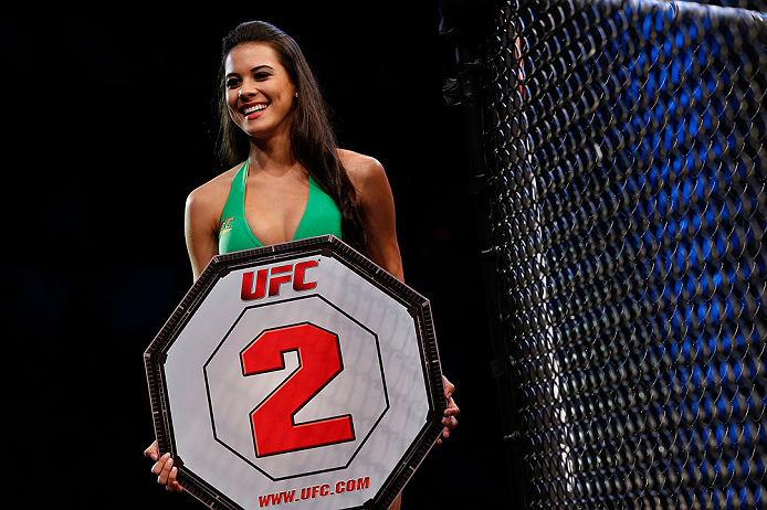 JARAGUA DO SUL, BRAZIL - MAY 18:   UFC Octagon Girl  Camila Rodrigues de Oliveira introduces a round during the UFC on FX event on May 18, 2013 at Arena Jaragua in Jaragua do Sul, Santa Catarina, Brazil.  (Photo by Josh Hedges/Zuffa LLC/Zuffa LLC via Getty Images)