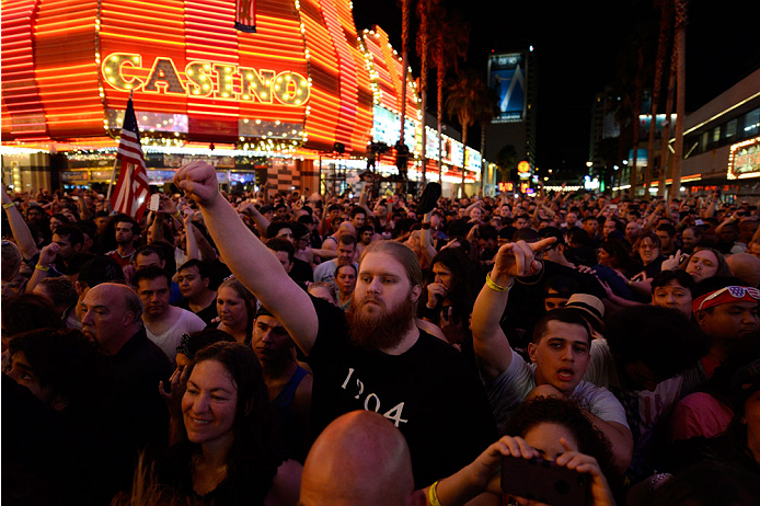 LAS VEGAS, NV - JULY 4:  Fans listen to P.O.D. perform during UFC International Fight Week Free Concert Featuring Lit, P.O.D., and Papa Roach at the Fremont Street Experience Las Vegas on July 2, 2014 in Las Vegas, Nevada. (Photo by Brandon Magnus/Zuffa LLC/Zuffa LLC via Getty Images)
