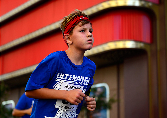 LAS VEGAS, NV - JULY 4:  A participate runs in the first annual Ulti-man 5K run during UFC International Fight Week at Hogs and Heifers on July 4, 2014 in Las Vegas, Nevada. Proceeds will help support Three Square Food Bank. (Photo by Brandon Magnus/Zuffa LLC/Zuffa LLC via Getty Images)