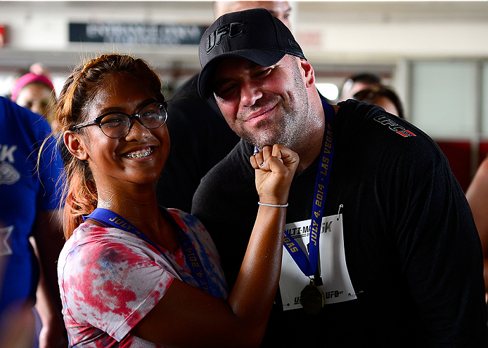 LAS VEGAS, NV - JULY 4:  UFC President Dana White takes a picture with a participate after the first annual Ulti-man 5K run during UFC International Fight Week at Hogs and Heifers on July 4, 2014 in Las Vegas, Nevada. Proceeds will help support Three Square Food Bank. (Photo by Brandon Magnus/Zuffa LLC/Zuffa LLC via Getty Images)