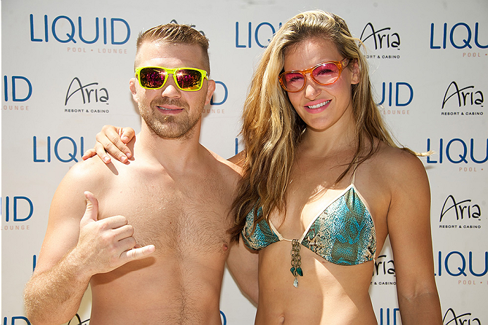 Mixed martial artists Brian Caraway (L) and Miesha Tate arrive at the UFC pool party during UFC International Fight Week at the Liquid Pool Lounge at the Aria Resort & Casino at CityCenter on July 3, 2014 in Las Vegas, NV. (Photo by Al Powers/Zuffa LLC)