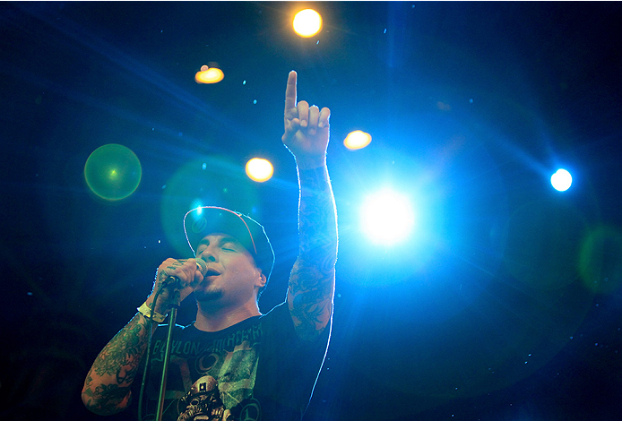 LAS VEGAS, NV - JULY 4:  Frontman Sonny Sandoval of P.O.D. performs in the rain during UFC International Fight Week Free Concert Featuring Lit, P.O.D., and Papa Roach at the Fremont Street Experience Las Vegas on July 2, 2014 in Las Vegas, Nevada. (Photo by Brandon Magnus/Zuffa LLC/Zuffa LLC via Getty Images)