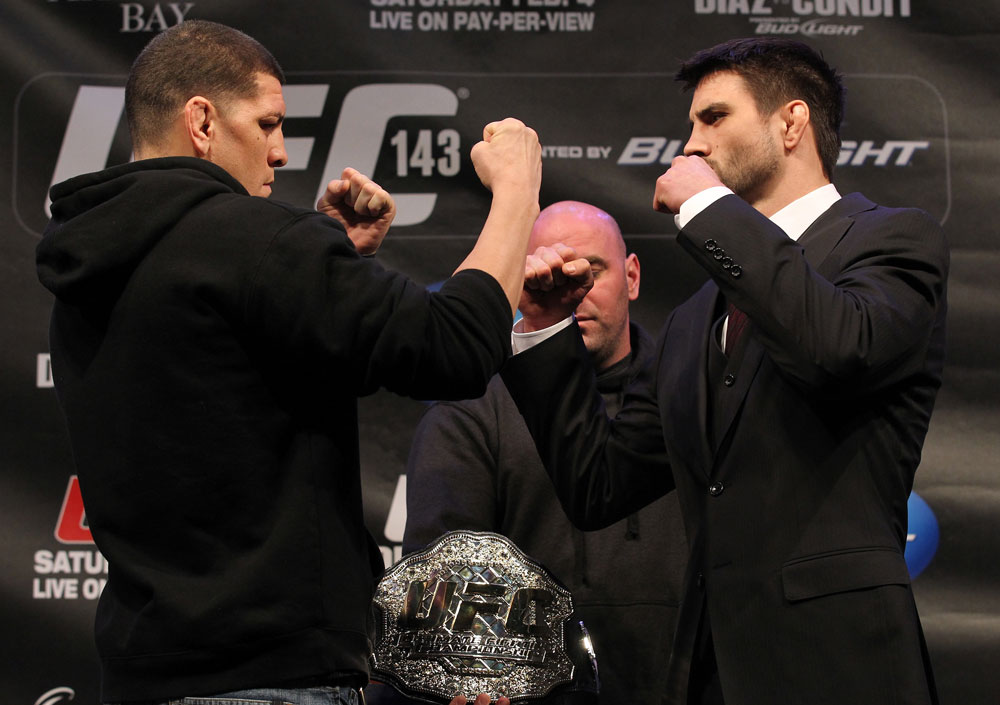 LAS VEGAS, NV - FEBRUARY 02:  (L-R) Opponents Nick Diaz and Carlos Condit face off during the UFC 143 final pre-fight press conference at the Mandalay Bay Hotel & Casino on February 2, 2012 in Las Vegas, United States.  (Photo by Josh Hedges/Zuffa LLC/Zuffa LLC via Getty Images) *** Local Caption *** Nick Diaz; Carlos Condit
