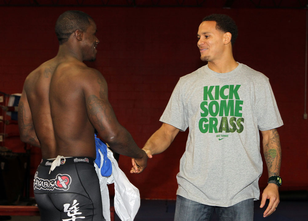 NASHVILLE, TN - JANUARY 18:  (R-L) Tennessee Titans defensive back Cortland Finnegan meets UFC fighter Melvin Guillard during the UFC on FX open workouts at the Nashville MMA Gym on January 18, 2012 in Nashville, Tennessee.  (Photo by Josh Hedges/Zuffa LLC/Zuffa LLC via Getty Images)