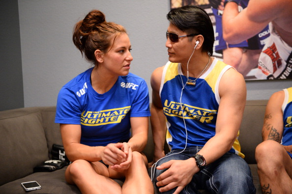 "LAS VEGAS, NV - JUNE 6:  (L-R) Coach Miesha Tate and trainer Thonglor ""Master Thong"" Armatsena discuss the upcoming preliminary fight between Julianna Pena and Shayna Baszler during filming of season eighteen of The Ultimate Fighter on June 6, 2013 in Las Vegas, Nevada. (Photo by Al Powers/Zuffa LLC/Zuffa LLC via Getty Images)"