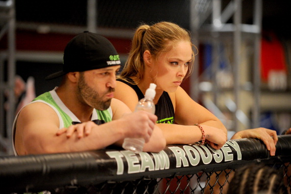 LAS VEGAS, NV - JUNE 6:  (L-R) Team Rousey trainer Manny Gamburyan and Coach Ronda Rousey look into the Octagon as Julianna Pena fights Shayna Baszler in their preliminary fight during filming of season eighteen of The Ultimate Fighter on June 6, 2013 in Las Vegas, Nevada. (Photo by Al Powers/Zuffa LLC/Zuffa LLC via Getty Images)