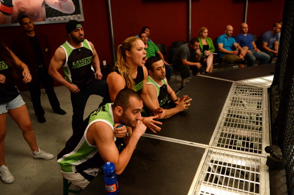 LAS VEGAS, NV - JUNE 6:  (L-R) Team Rousey trainer Manny Gamburyan, trainer Edmond Tarverdyan and Coach Ronda Rousey look into the Octagon as Julianna Pena fights Shayna Baszler in their preliminary fight during filming of season eighteen of The Ultimate Fighter on June 6, 2013 in Las Vegas, Nevada. (Photo by Al Powers/Zuffa LLC/Zuffa LLC via Getty Images)
