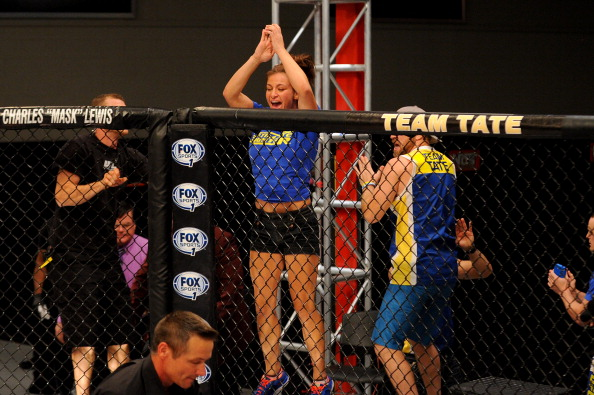LAS VEGAS, NV - JUNE 6:  Coach Miesha Tate celebrates after Julianna Pena submits Shayna Baszler in their preliminary fight during filming of season eighteen of The Ultimate Fighter on June 6, 2013 in Las Vegas, Nevada. (Photo by Al Powers/Zuffa LLC/Zuffa LLC via Getty Images)