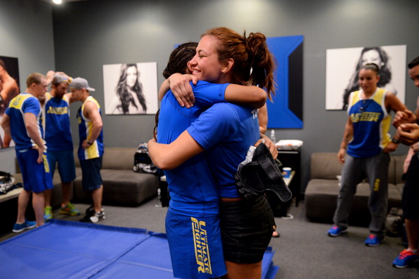 LAS VEGAS, NV - JUNE 6:  (L-R) Julianna Pena is embraced by Coach Miesha Tate after defeating Shayna Baszler (not pictured) by submission in their preliminary fight during filming of season eighteen of The Ultimate Fighter on June 6, 2013 in Las Vegas, Nevada. (Photo by Al Powers/Zuffa LLC/Zuffa LLC via Getty Images)