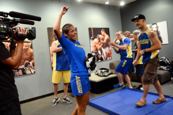 LAS VEGAS, NV - JUNE 6:  Julianna Pena (C) celebrates with her team after being declared winner against Shayna Baszler (not pictured) by submission in their preliminary fight during filming of season eighteen of The Ultimate Fighter on June 6, 2013 in Las Vegas, Nevada. (Photo by Al Powers/Zuffa LLC/Zuffa LLC via Getty Images)