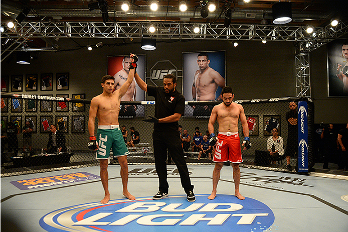 LAS VEGAS, NV - JUNE 18:  (L-R) Team Velasquez fighter Yair Rodriguez celebrates after defeating team Velasquez fighter Rodolfo Rubio in their semifinal fight during filming of The Ultimate Fighter Latin America on June 18, 2014 in Las Vegas, Nevada. (Photo by Al Powers/Zuffa LLC/Zuffa LLC via Getty Images) *** Local Caption ***Rodolfo Rubio;Yair Rodriguez