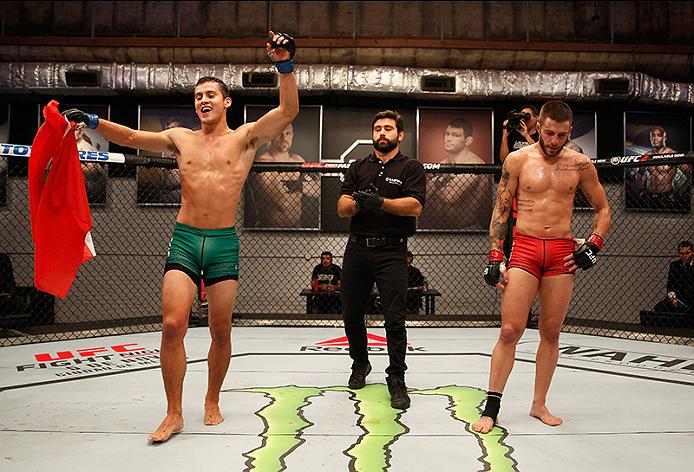 Claudio Puelles celebrates his victory over Marcelo Rojo as he advances to <a href='../event/Ultimate-Fighter-Team-Serra-vs-Team-Hughes-Finale'><a href='../event/The-Ultimate-Fighter-Team-US-vs-Team-UK-FINALE'><a href='../event/The-Ultimate-Fighter-Heavyweights-FINALE'>The Ultimate fighter:</a></a></a> Latin America Finale.