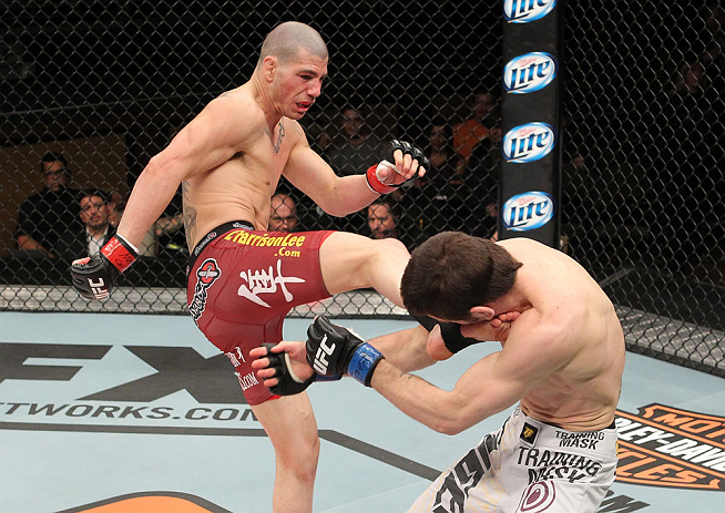 LAS VEGAS, NV - DECEMBER 15:  (L-R) Jared Papazian kicks Timothy Elliott during their flyweight fight at the TUF 16 Finale on December 15, 2012  at the Joint at the Hard Rock in Las Vegas, Nevada.  (Photo by Jim Kemper/Zuffa LLC/Zuffa LLC via Getty Images) *** Local Caption ***Jared Papazian; Timothy Elliott