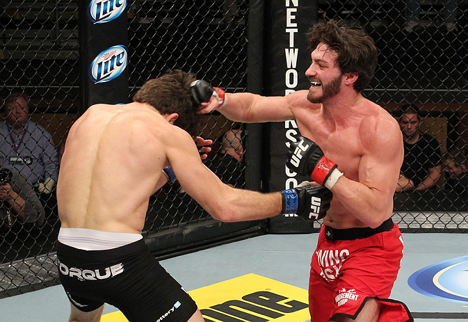 LAS VEGAS, NV - DECEMBER 15:  (R-L) Mike Rio punches John Cofer during their lightweight fight at the TUF 16 Finale on December 15, 2012  at the Joint at the Hard Rock in Las Vegas, Nevada.  (Photo by Jim Kemper/Zuffa LLC/Zuffa LLC via Getty Images) *** Local Caption *** Mike Rio; John Cofer
