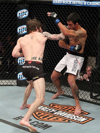 LAS VEGAS, NV - DECEMBER 15:  (L-R) Johnny Bedford punches Marcos Vinicius during their bantamweight fight at the TUF 16 Finale on December 15, 2012  at the Joint at the Hard Rock in Las Vegas, Nevada.  (Photo by Jim Kemper/Zuffa LLC/Zuffa LLC via Getty Images) *** Local Caption *** Johny Bedford; Marcos Vinicius