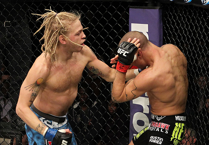 LAS VEGAS, NV - DECEMBER 15:  (L-R) Jonathan Brookins punches Dustin Poirier during their featherweight fight at the TUF 16 Finale on December 15, 2012  at the Joint at the Hard Rock in Las Vegas, Nevada.  (Photo by Jim Kemper/Zuffa LLC/Zuffa LLC via Getty Images) *** Local Caption *** Dustn Poirier; Jonathan Brookins