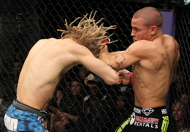 LAS VEGAS, NV - DECEMBER 15:  (R-L) Dustin Poirier punches Jonathan Brookins during their featherweight fight at the TUF 16 Finale on December 15, 2012  at the Joint at the Hard Rock in Las Vegas, Nevada.  (Photo by Jim Kemper/Zuffa LLC/Zuffa LLC via Getty Images) *** Local Caption *** Dustn Poirier; Jonathan Brookins